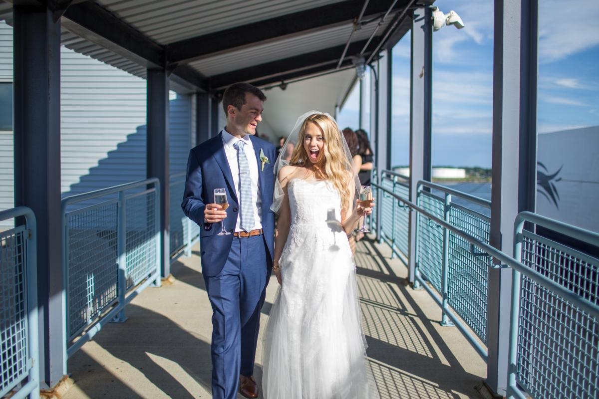 Ocean Gateway Wedding Bride and Groom Champagne
