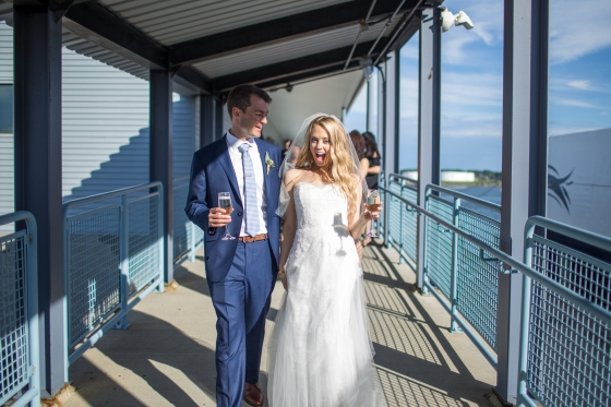 Ocean Gateway Wedding Bride and Groom Champagne
