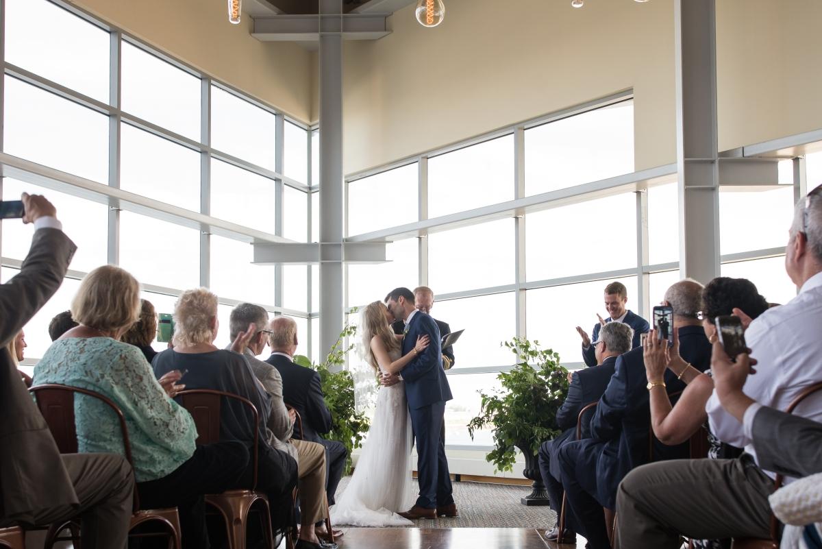 Ocean Gateway Wedding Wedding Ceremony First Kiss