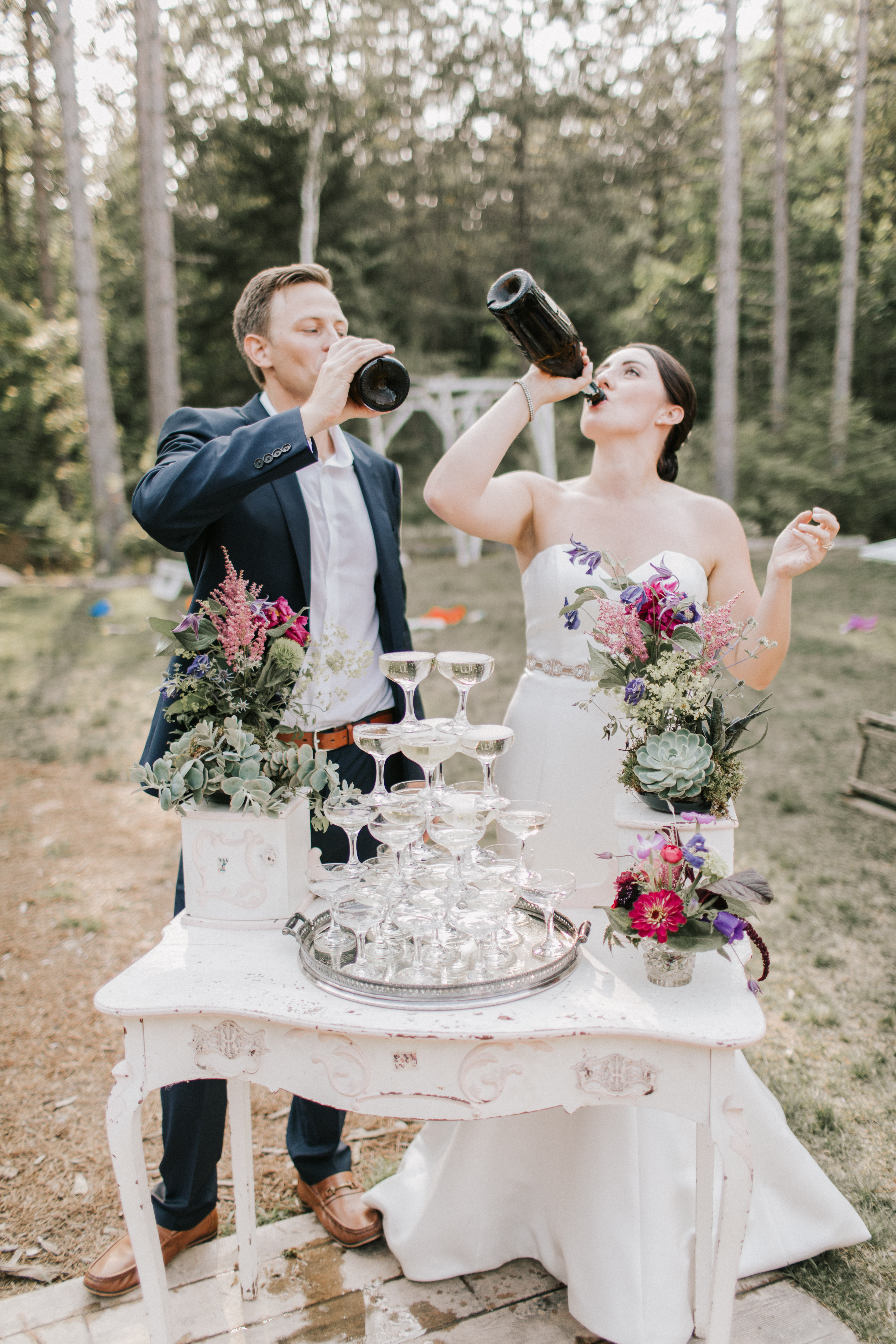 Bride and Groom drinking champagne at Hidden Pond Wedding in Kennebunkport, Maine