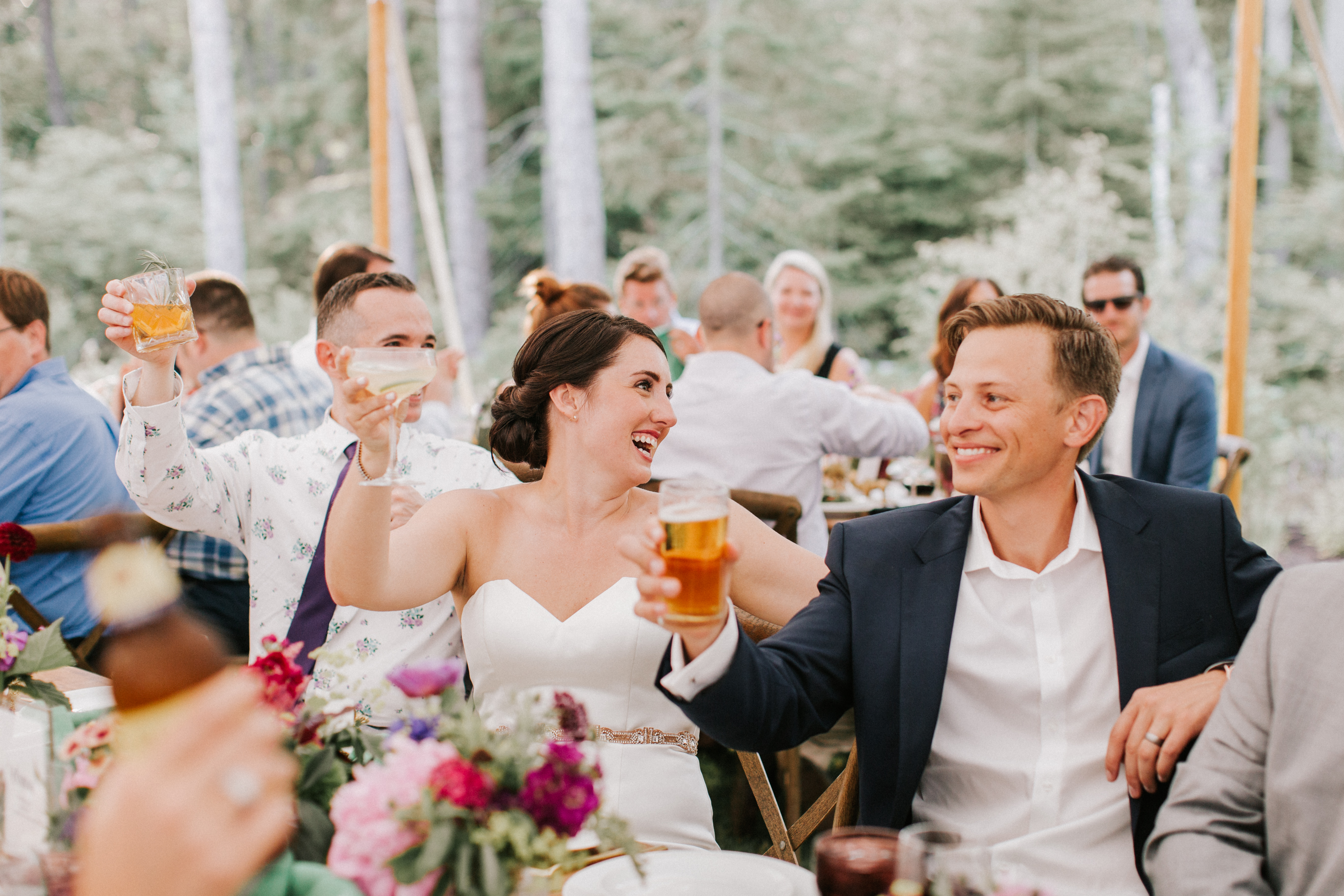 Bride and Groom toasting at Hidden Pond Wedding in Kennebunkport, Maine