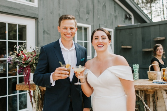 Bride and Groom at cocktail hour at Hidden Pond wedding in Kennebunkport, Maine