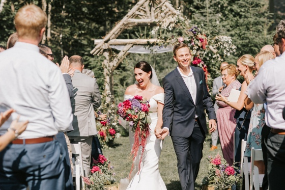 Bride and Groom walking down aisle at  Hidden Pond wedding in Kennebunkport, Maine