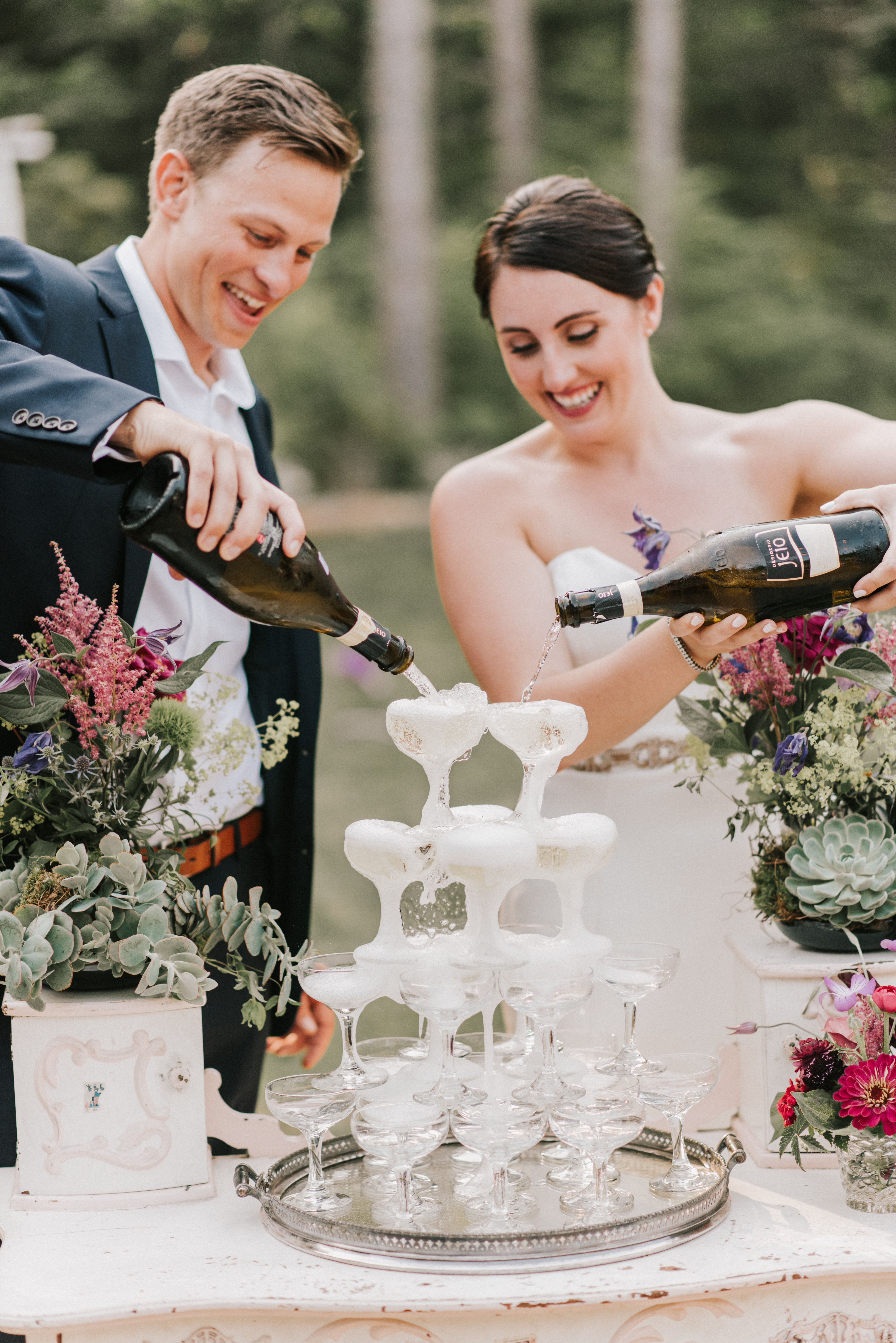 Bride and Groom champagne tower at Hidden Pond Wedding in Kennebunkport, Maine