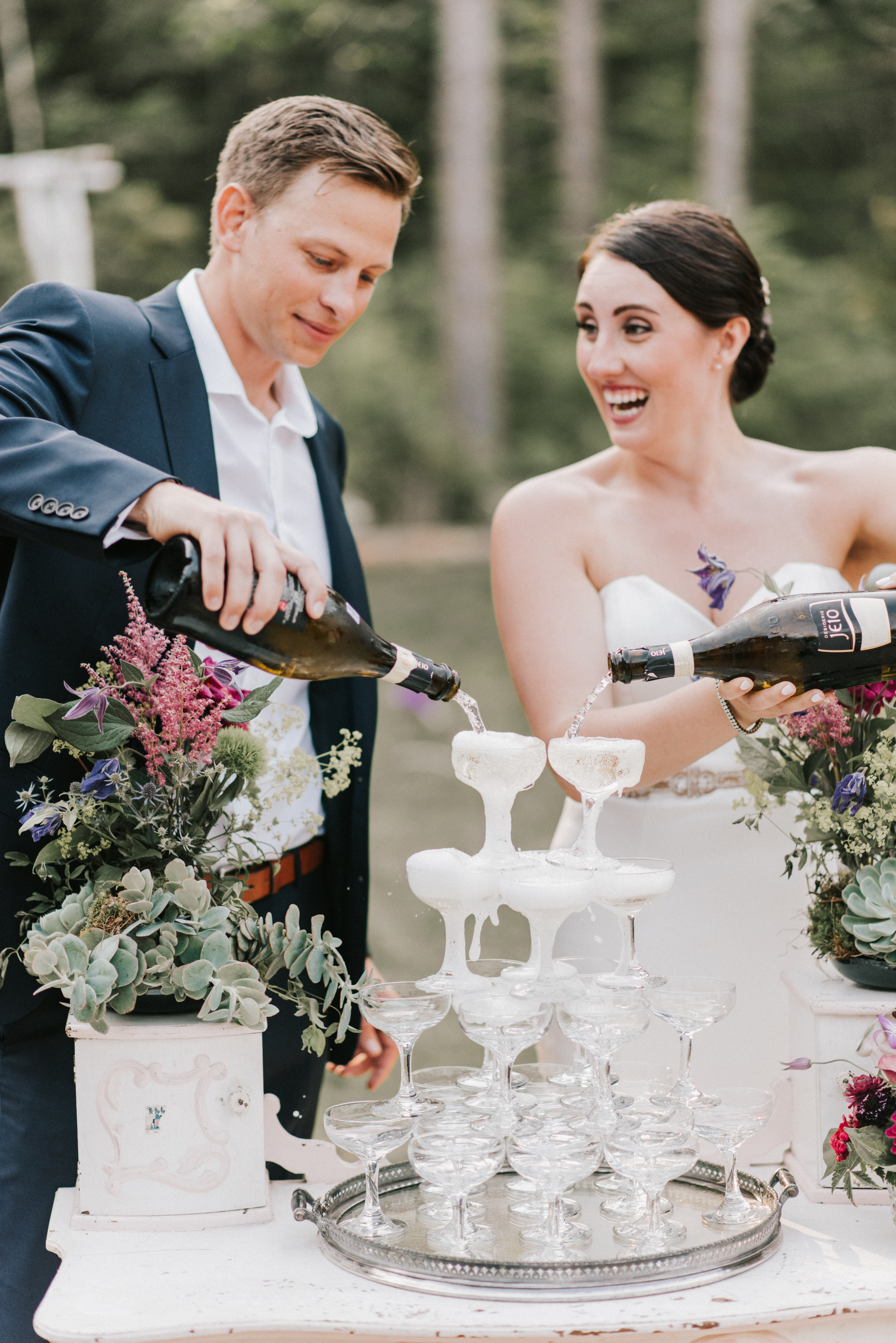 Bride and Groom pouring champagne at Hidden Pond Wedding in Kennebunkport, Maine