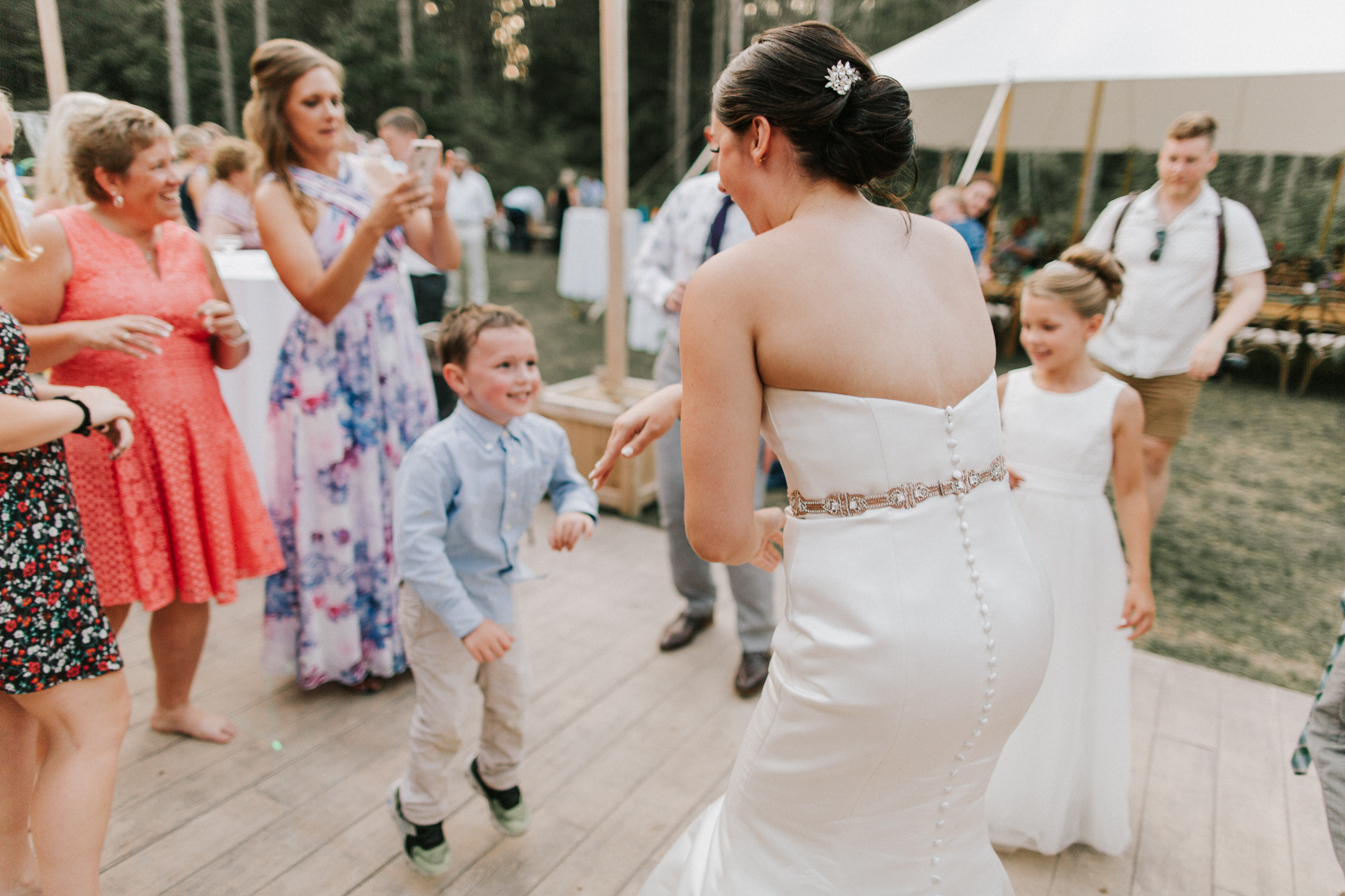 Bride dancing with children at Hidden Pond Wedding in Kennebunkport, Maine