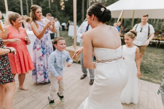 Bride dancing with children at Hidden Pond Wedding in Kennebunkport, Maine