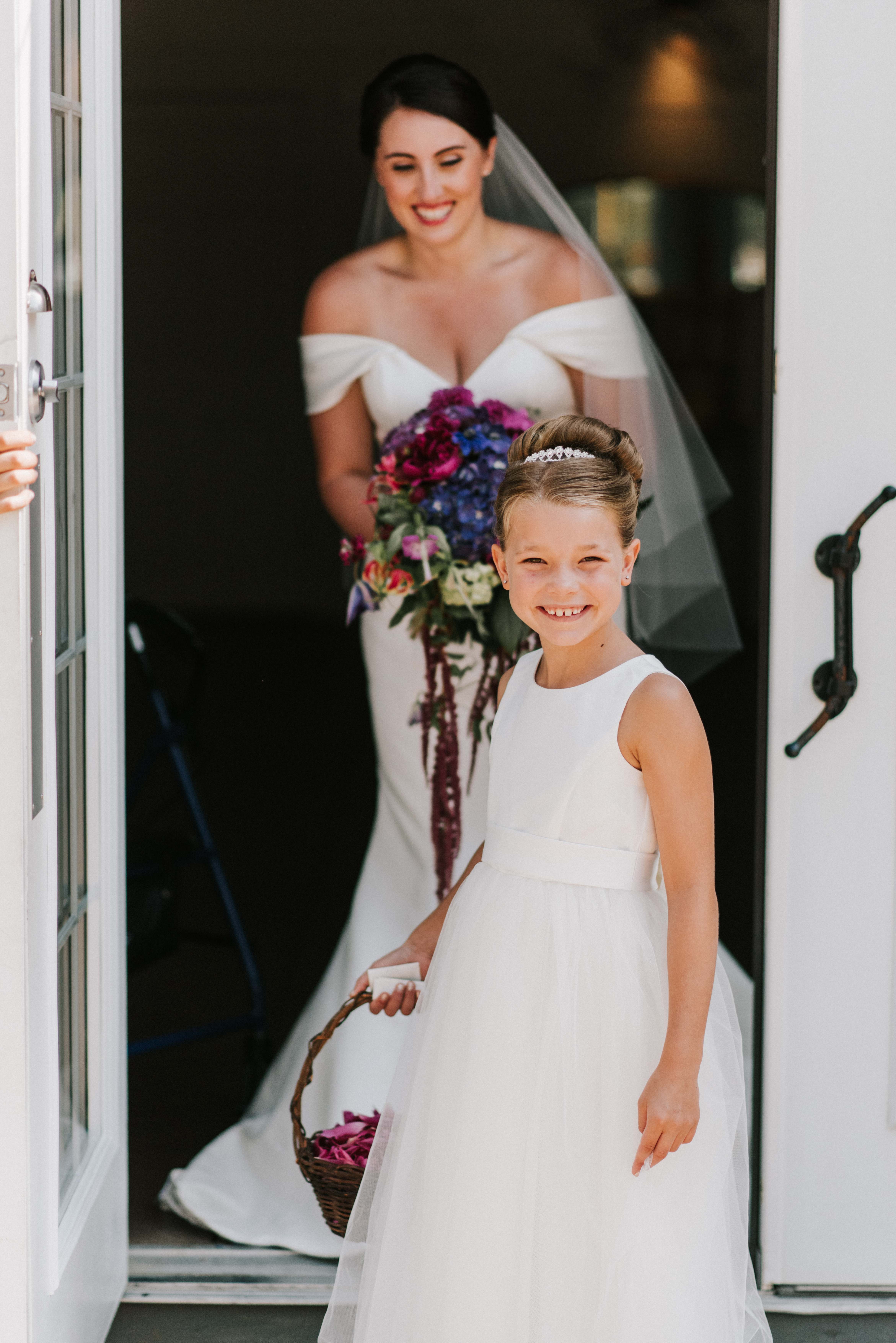 Flower girl at  Hidden Pond wedding in Kennebunkport, Maine