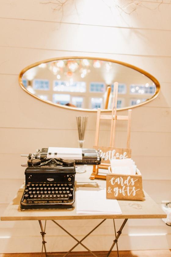 Guestbook with vintage typewriter at at Hidden Pond Wedding in Kennebunkport, Maine