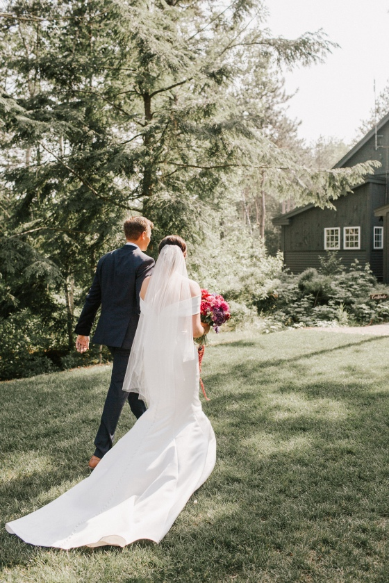 Bride and Groom post-ceremony at  Hidden Pond wedding in Kennebunkport, Maine