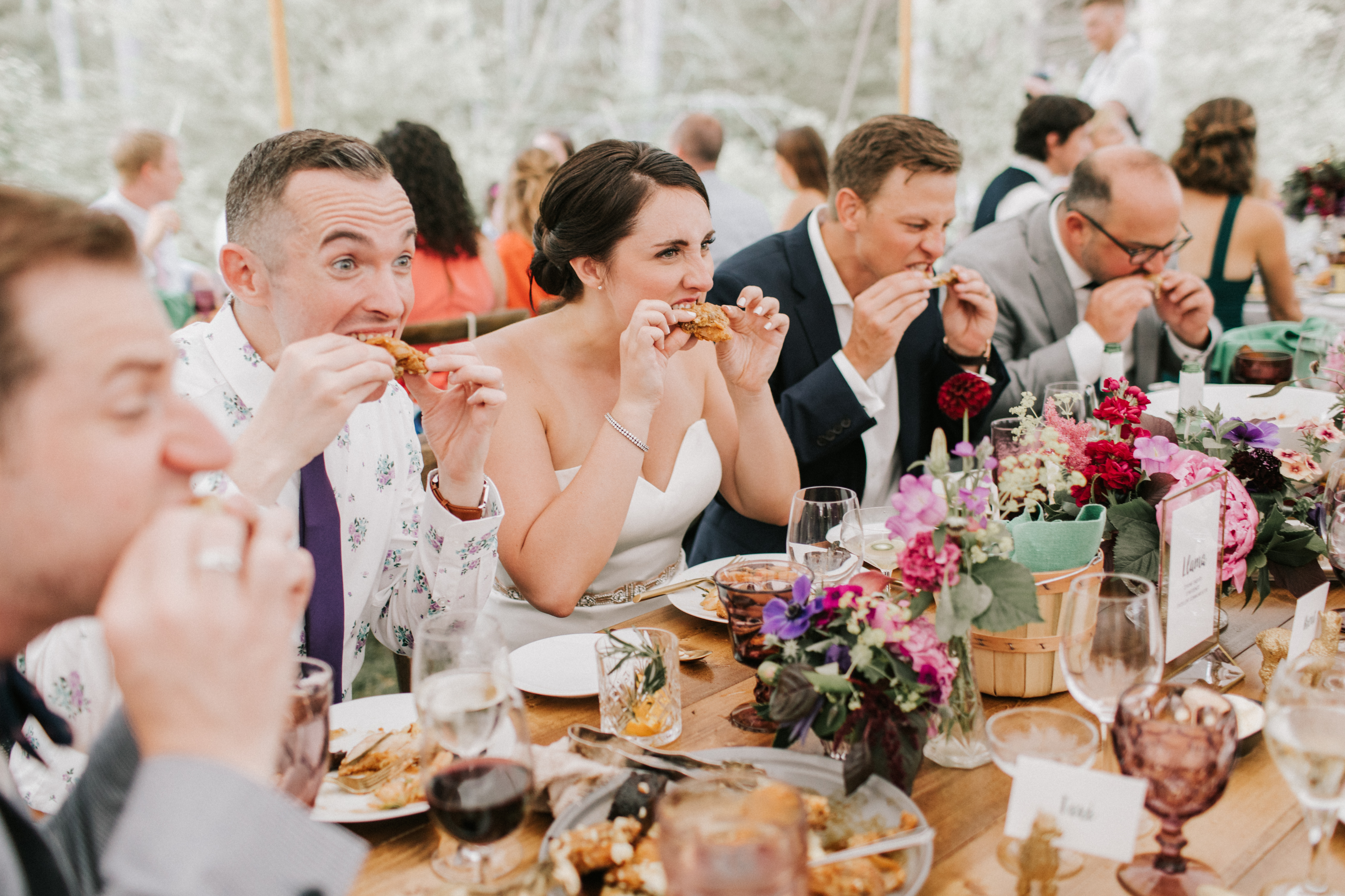 Wedding guests eating fried chicken at Hidden Pond Wedding in Kennebunkport, Maine