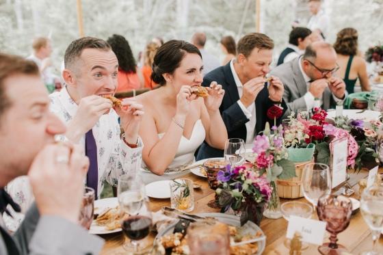 Wedding guests eating fried chicken at Hidden Pond Wedding in Kennebunkport, Maine