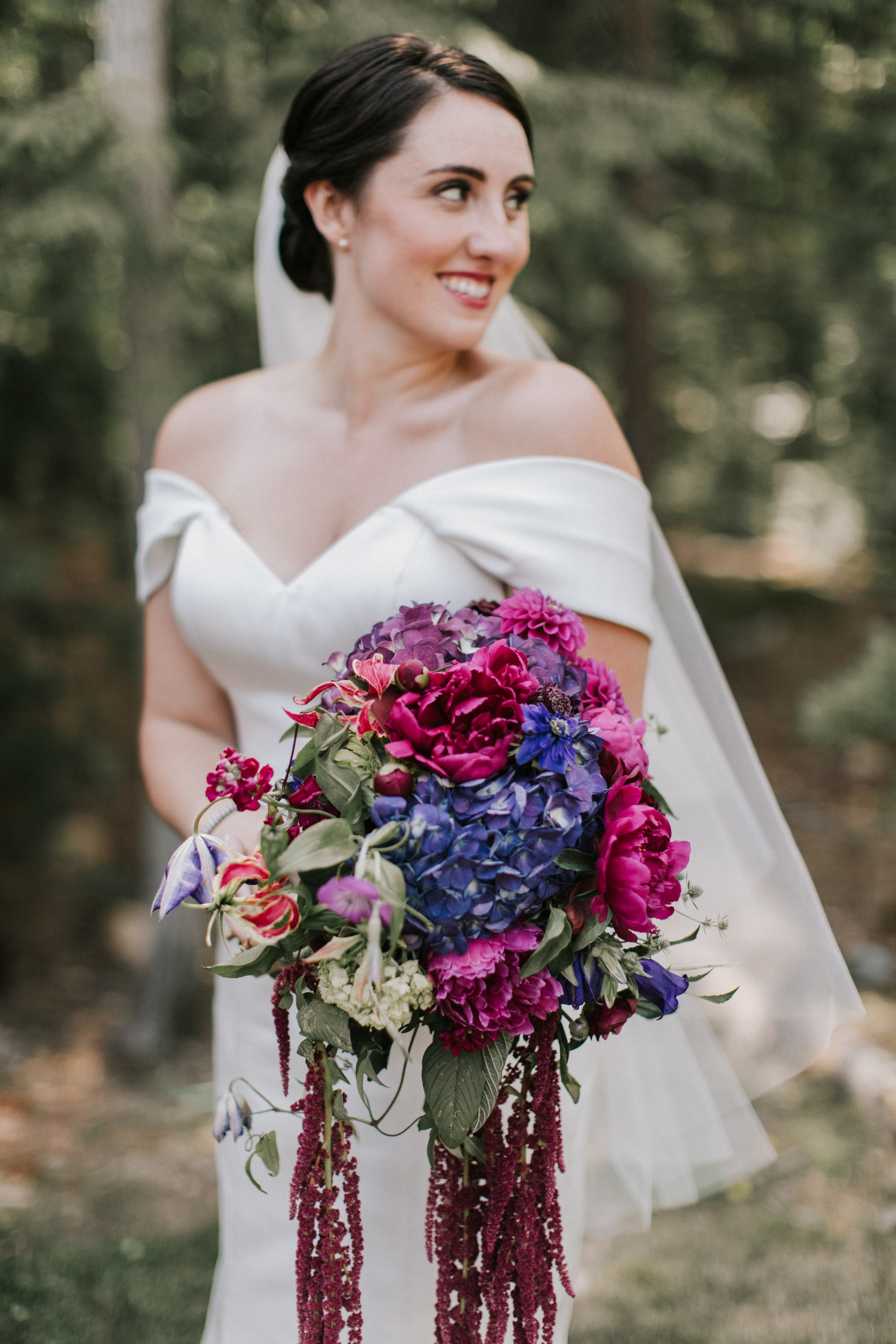 Bridal portrait with bouquet at Hidden Pond wedding planned by A Family Affair of Maine